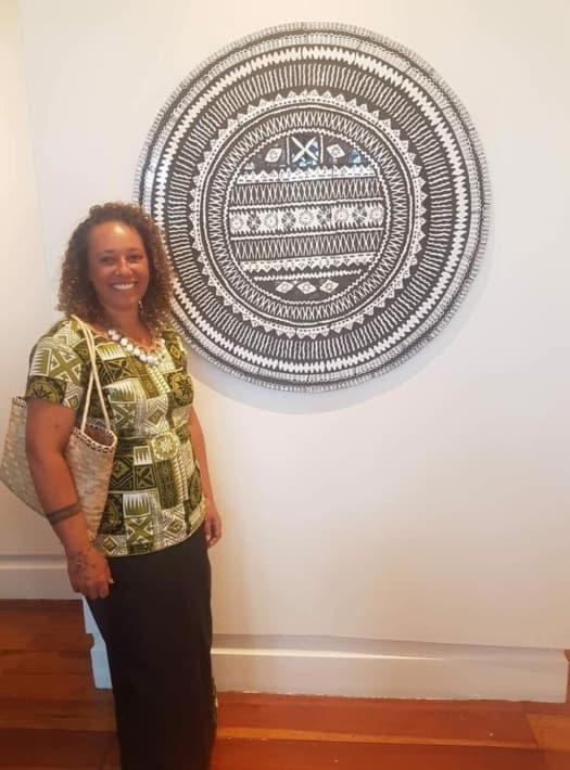 Rowena Rooney with her gallery exhibit